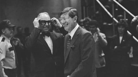 FILE - In this Nov. 20, 1986, file photo, New York Islanders general manager Bill Torrey, left, and former Islanders coach Al Arbour grin as Torrey mimics Arbour's glasses during ceremonies honoring Arbour at the Nassau Coliseum in Uniondale, N.Y. Torrey, the general manager of the New York Islanders when they won four consecutive Stanley Cups in the 1980s and the first president of the Florida Panthers, died Thursday, May 4, 2018. The Panthers and the NHL announced Torrey's death. He was 83. (AP Photo/Ray Stubblebine, File)
