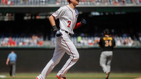 Washington Nationals' Trea Turner (7) circles the bases after hitting a two-run homer off Pittsburgh Pirates starting pitcher Trevor Williams (34), during the sixth inning of a baseball game at Nationals Park, Thursday, May 3, 2018, in Washington. (AP Photo/Pablo Martinez Monsivais)