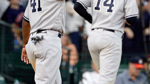 New York Yankees' Miguel Andujar (41) gestures towards Gleyber Torres at first base after his single scored both Andujar and Neil Walker (14) in the ninth inning of a baseball game against the Houston Astros Thursday, May 3, 2018, in Houston. (AP Photo/Michael Wyke)
