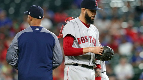 Boston Red Sox starting pitcher David Price walks off the mound after turning the ball over to manager Alex Cora in the fourth inning of a baseball game against the Texas Rangers in Arlington, Texas, Thursday, May 3, 2018. (AP Photo/Richard Rodriguez)