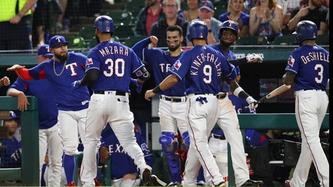 Texas Rangers' Nomar Mazara (30), Isiah Kiner-Falefa (9) and Delino DeShields (3) return to the dugout after Mazara hit a three-run home run off Boston Red Sox relief pitcher Hector Velazquez during the fourth inning of a baseball game in Arlington, Texas, Thursday, May 3, 2018. (AP Photo/Richard Rodriguez)