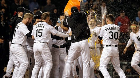 Chicago White Sox's Trayce Thompson, center, is congratulated by teammates after hitting the game-winning solo home run against the Minnesota Twins in a baseball game Thursday, May 3, 2018, in Chicago. The White Sox won 6-5. (AP Photo/Nam Y. Huh)
