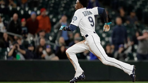 Seattle Mariners' Dee Gordon runs to third base after a throwing error charged to Oakland Athletics catcher Jonathan Lucroy as Gordon was stealing second base during the seventh inning of a baseball game Thursday, May 3, 2018, in Seattle. (AP Photo/Ted S. Warren)