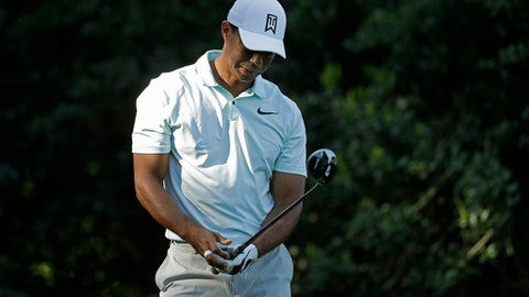 Tiger Woods reacts to his tee shot on the 14th hole during the second round of the Wells Fargo Championship golf tournament at Quail Hollow Club in Charlotte, N.C., Friday, May 4, 2018. (AP Photo/Chuck Burton)