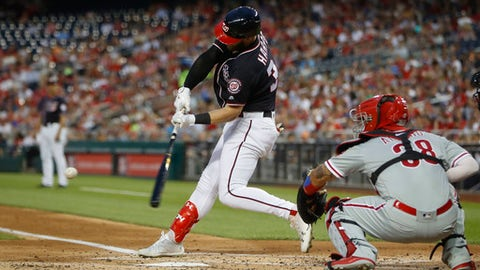 Washington Nationals' Bryce Harper, left, hits a two-run home run off Philadelphia Phillies starting pitcher Nick Pivetta (not shown) during the second inning of a baseball game at Nationals Park, Friday, May 4, 2018, in Washington. Phillies catcher Jorge Alfaro, right,  looks on. (AP Photo/Pablo Martinez Monsivais)