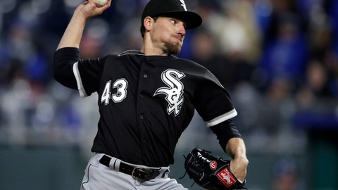 FILE - In this March 31, 2018, file photo, Chicago White Sox relief pitcher Danny Farquhar throws during the team's baseball game against the Kansas City Royals at Kauffman Stadium in Kansas City, Mo. Minnesota Twins' Logan Morrison and Jake Odorizzi were encouraged after visiting former teammate Farquhar in the hospital Friday, May 4. Morrison was really blown away at how well Farquhar was doing after collapsing in the dugout with a ruptured aneurysm on April 20. Odorizzi says when he walked into the room at Rush University Medical Center, Farquhar stood from a couch and hugged him. (AP Photo/Orlin Wagner, File)