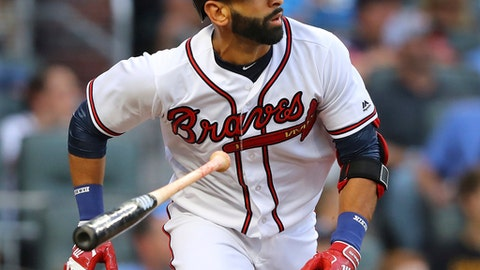 Atlanta Braves' Jose Bautista hitss a double during his first at-bat for the team during the first inning against the San Francisco Giants in a baseball game Friday, May 4, 2018, in Atlanta. (Curtis Compton/Atlanta Journal-Constitution via AP)