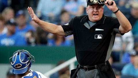 Home plate umpire Jeff Nelson addresses the Detroit Tigers bench during the first inning of the Tigers' baseball game against the Kansas City Royals at Kauffman Stadium in Kansas City, Mo., Friday, May 4, 2018. (AP Photo/Orlin Wagner)