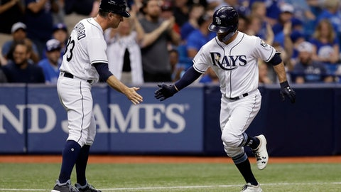 Tampa Bay Rays' Johnny Field, right, shakes hands with third base coach Matt Quatraro after Field hit a home run off Toronto Blue Jays starting pitcher J.A. Happ during the third inning of a baseball game Friday, May 4, 2018, in St. Petersburg, Fla. (AP Photo/Chris O'Meara)