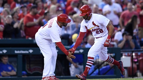 St. Louis Cardinals' Tommy Pham (28) celebrates with third base coach Jose Oquendo (11) as he rounds the bases after hitting a two-run home run during a baseball game against the Chicago Cubs on Friday, May 4, 2018, in St. Louis. (AP Photo/Michael Thomas)