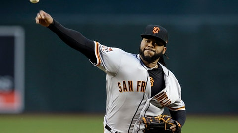 FILE - In this April 17, 2018, file photo, San Francisco Giants starting pitcher Johnny Cueto throws in the first inning during a baseball game against the Arizona Diamondbacks in Phoenix. Cueto was placed on the disabled list this week with inflammation in his right elbow after going 3-0 with a major league-leading 0.84 ERA in five starts. Cueto hopes to avoid season-ending Tommy John surgery. (AP Photo/Rick Scuteri, File)