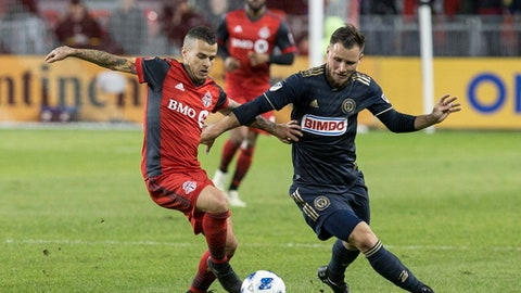 Toronto FC forward Sebastian Giovinco, left, battles for the ball with Philadelphia Union defender Keegan Rosenberry during the second half of an MLS soccer match Friday, May 4, 2018, in Toronto. (Chris Young/The Canadian Press via AP)