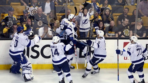 Tampa Bay Lightning defenseman Dan Girardi (5) and teammates celebrate his overtime goal against the Boston Bruins in Game 4 of an NHL hockey second-round playoff series Friday, May 4, 2018, in Boston. The Lightning won 4-3. (AP Photo/Elise Amendola)