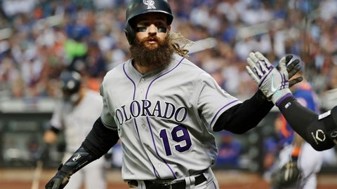 Colorado Rockies' Charlie Blackmon (19) celebrates with a teammate after hitting a home run during the second inning of a baseball game against the New York Mets on Friday, May 4, 2018, in New York. The Rockies won 8-7. (AP Photo/Frank Franklin II)