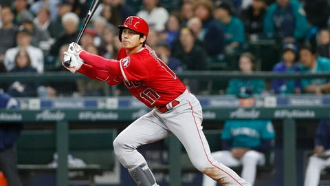 Los Angeles Angels' Shohei Ohtani follows through on an RBI double against the Seattle Mariners during the fifth inning of a baseball game Friday, May 4, 2018, in Seattle. (AP Photo/Jason Redmond)