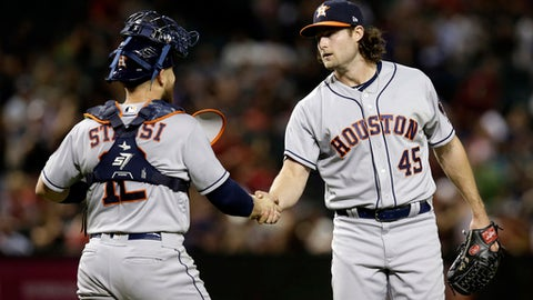 Houston Astros pitcher Gerrit Cole (45) celebrates with Max Stassi after the Astros defeated the Arizona Diamondbacks 8-0 during a baseball game, Friday, May 4, 2018, in Phoenix. (AP Photo/Rick Scuteri)