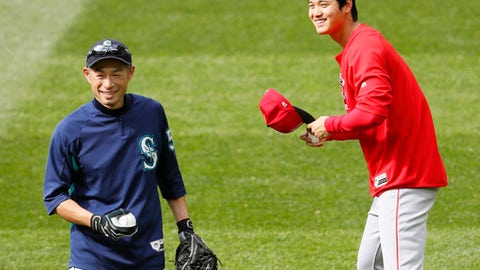 Los Angeles Angels' Shohei Ohtani, right, and former Seattle Mariners outfielder Ichiro Suzuki, left, share a light moment during a practice session Friday May 4, 2018 in Seattle, Washington. Suzuki was released May 4, 2018 by the Mariners and was shifting into a front office role with the team, although he is not completely shutting the door on playing again. (Shizuka Minami/Kyodo News via AP)