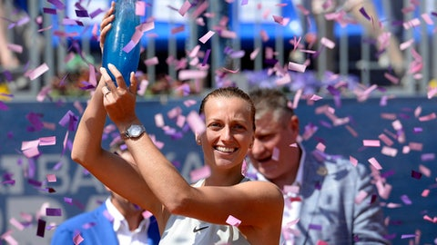 Czech tennis player Petra Kvitova celebrates with a trophy after defeating Mihaela Buzarnescu of Romania in the Prague Open final match in Prague on Saturday, May 5, 2018. (Katerina Sulova/CTK via AP)