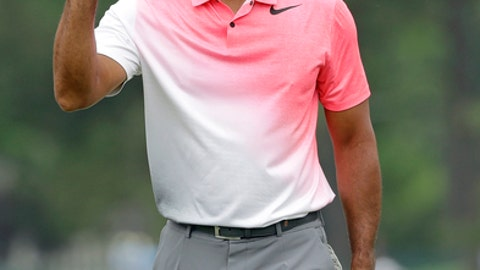 Tiger Woods waves to the crowd after making a birdie putt on the fifth hole during the third round of the Wells Fargo Championship golf tournament at Quail Hollow Club in Charlotte, N.C., Saturday, May 5, 2018. (AP Photo/Chuck Burton)