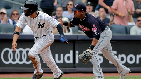 New York Yankees' Gleyber Torres, left, breaks for home after a throwing error to Cleveland Indians third baseman Jose Ramirez during the fifth inning of a baseball game, Saturday, May 5, 2018, in New York. Torres scored on the play. (AP Photo/Julie Jacobson)