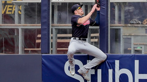 Cleveland Indians center fielder Bradley Zimmer slams into the wall while trying to catch a ball hit deep by New York Yankees' Austin Romine during the seventh inning of a baseball game, Saturday, May 5, 2018, in New York. Romine was credited with a double on the play. (AP Photo/Julie Jacobson)