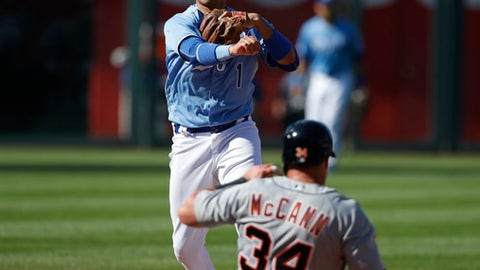 Detroit Tigers' James McCann (34) slides into a double play as Kansas City Royals second baseman Ryan Goins (1) throws to first in the sixth inning of a baseball game at Kauffman Stadium in Kansas City, Mo., Saturday, May 5, 2018. Julio Iglesias was out at first. (AP Photo/Colin E. Braley)