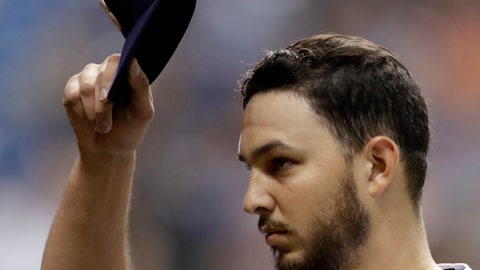 Tampa Bay Rays starting pitcher Jacob Faria tips his cap to the crowd after being taken out of the baseball game against the Toronto Blue Jays during the sixth inning Saturday, May 5, 2018, in St. Petersburg, Fla. (AP Photo/Chris O'Meara)