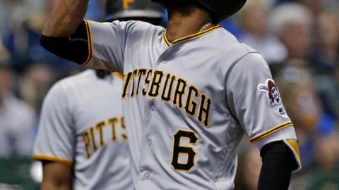 Pittsburgh Pirates' Starling Marte gestures after hitting a two-run home run during the eighth inning of a baseball game against the Pittsburgh Pirates on Saturday, May 5, 2018, in Milwaukee. (AP Photo/Aaron Gash)