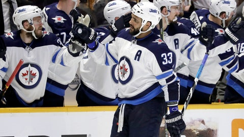 Winnipeg Jets defenseman Dustin Byfuglien (33) is congratulated after scoring a goal against the Nashville Predators during the second period in Game 5 of an NHL hockey second-round playoff series Saturday, May 5, 2018, in Nashville, Tenn. (AP Photo/Mark Humphrey)