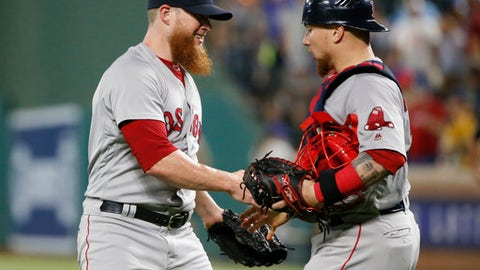 Boston Red Sox relief pitcher Craig Kimbrel, left, celebrates with catcher Christian Vazquez, right, after they defeated the Texas Rangers during a baseball game Saturday, May 5, 2018, in Arlington, Texas. (AP Photo/Michael Ainsworth)