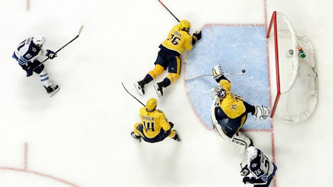 Winnipeg Jets left wing Kyle Connor (81) scores a goal against Nashville Predators goalie Pekka Rinne (35), of Finland, during the second period in Game 5 of an NHL hockey second-round playoff series Saturday, May 5, 2018, in Nashville, Tenn. Also defending for the Predators are Mattias Ekholm (14), of Sweden, and P.K. Subban (76). (AP Photo/Mark Humphrey)
