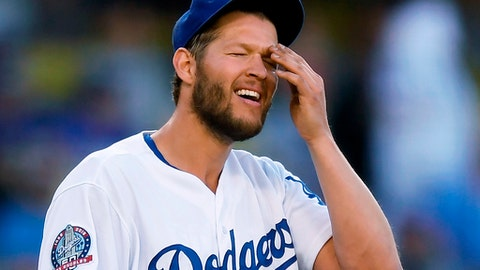 FILE - In this April 25, 2018, file photo, Los Angeles Dodgers starting pitcher Clayton Kershaw wipes his face after giving up a three-run home run to Miami Marlins' Miguel Rojas during the fifth inning of a baseball game in Los Angeles. Dodgers ace Clayton Kershaw was put on the 10-day disabled list with left biceps tendinitis. A three-time NL Cy Young Award winner, Kershaw is on the disabled list for the fourth time. (AP Photo/Mark J. Terrill,m File)