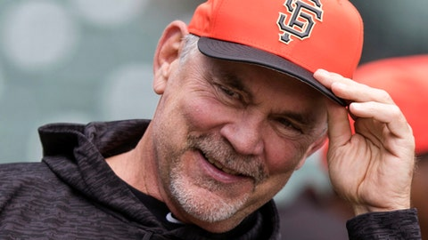 FILE - In this April 7, 2018, file photo, San Francisco Giants manager Bruce Bochy watches batting practice before a baseball game against the Los Angeles Dodgers in San Francisco. Bochy has made only six posts since opening his Twitter account in November, 2017.  He may spend more time on social media after enjoying the reaction from Braves right-hander Brandon McCarthy and McCarthys wife, Amanda, to his latest post. (AP Photo/John Hefti, File)