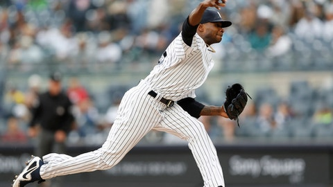 New York Yankees starting pitcher Domingo German delivers during the first inning of a baseball game against the Cleveland Indians in New York, Sunday, May 6, 2018. (AP Photo/Kathy Willens)