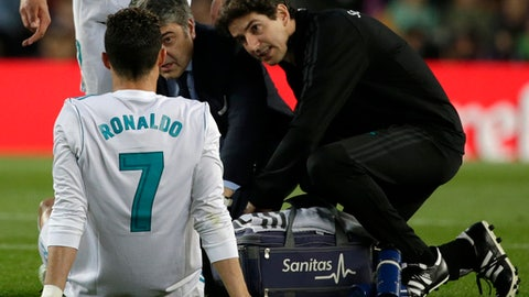 Real Madrid's Cristiano Ronaldo is treated for an injury after scoring his side's first goal during a Spanish La Liga soccer match between Barcelona and Real Madrid, dubbed 'El Clasico', at the Camp Nou stadium in Barcelona, Spain, Sunday, May 6, 2018. (AP Photo/Emilio Morenatti)