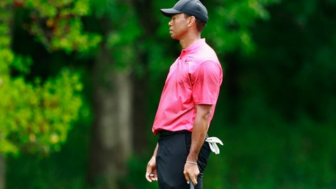 Tiger Woods reacts to his shot on the 11th hole during the final round of the Wells Fargo Championship golf tournament at Quail Hollow Club in Charlotte, N.C., Sunday, May 6, 2018. (AP Photo/Jason E. Miczek)