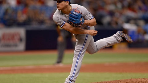 Toronto Blue Jays relief pitcher Roberto Osuna (54) throws a pitch during the ninth inning of a baseball game against the Tampa Bay Rays Sunday, May 6, 2018, in St. Petersburg, Fla. (AP Photo/Jason Behnken)