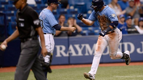 Tampa Bay Rays' Carlos Gomez (27) rounds the bases after his eightth inning home run during a baseball game against the Toronto Blue Jays Sunday, May 6, 2018, in St. Petersburg, Fla. (AP Photo/Jason Behnken)