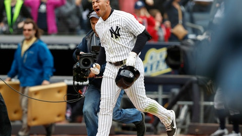 New York Yankees' Gleyber Torres reacts as he runs home on his ninth-inning, walk-off, three-run, home run against the Cleveland Indians in a baseball game in New York, Sunday, May 6, 2018. The Yankees won 7-4. (AP Photo/Kathy Willens)