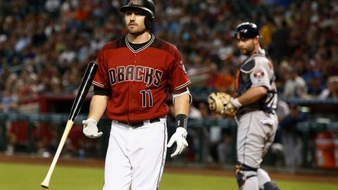 Arizona Diamondbacks' A.J. Pollock (11) flips his bat in the air after striking out as Houston Astros catcher Brian McCann, right, looks on during the first inning of a baseball game Sunday, May 6, 2018, in Phoenix. (AP Photo/Ross D. Franklin)