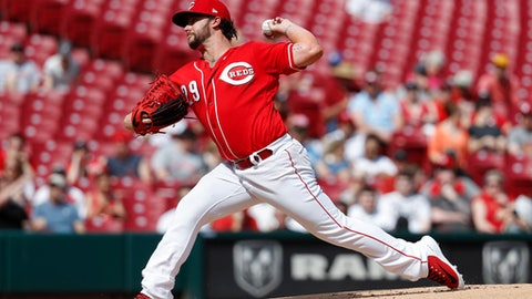 Cincinnati Reds starting pitcher Brandon Finnegan throws in the first inning of a baseball game against the Miami Marlins, Sunday, May 6, 2018, in Cincinnati. (AP Photo/John Minchillo)