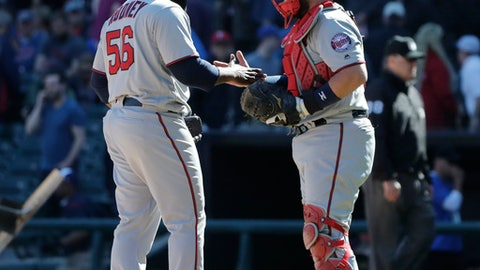 Minnesota Twins closer Fernando Rodney, left, celebrates with catcher Bobby Wilson after they defeated the Chicago White Sox in a baseball game Sunday, May 6, 2018, in Chicago. (AP Photo/Nam Y. Huh)