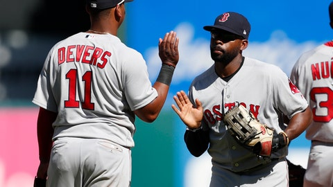 Boston Red Sox's Rafael Devers (11) and Jackie Bradley Jr., right, congratulate each other following a baseball game against the Texas Rangers, Sunday, May 6, 2018, in Arlington, Texas. (AP Photo/Jim Cowsert)