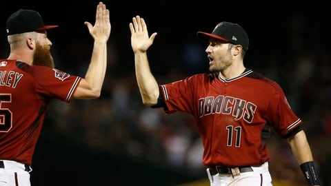 Arizona Diamondbacks center fielder A.J. Pollock (11) celebrates with relief pitcher Archie Bradley, left, after the final out of a baseball game against the Houston Astros, Sunday, May 6, 2018, in Phoenix. (AP Photo/Ross D. Franklin)