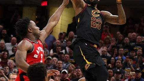 CLEVELAND, OH - MAY 05:  LeBron James #23 of the Cleveland Cavaliers hits the game winning shot over the outstretched hand of OG Anunoby #3 of the Toronto Raptors to win Game Three of the Eastern Conference Semifinals 105-103 during the 2018 NBA Playoffs at Quicken Loans Arena on May 5, 2018 in Cleveland, Ohio. (Photo by Gregory Shamus/Getty Images)