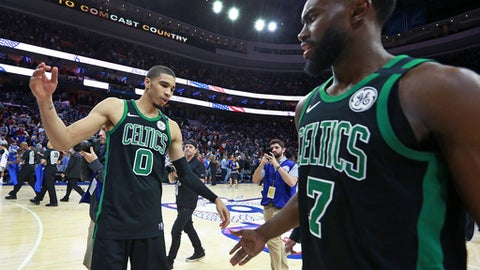 PHILADELPHIA, PA - MAY 5: Boston Celtics Jayson Tatum, left, and Jaylen Brown, right, congratulate each other following their team's overtime victory. The Philadelphia 76ers host the Boston Celtics in Game Three of the Eastern Conference semifinals at the Wells Fargo Center in Philadelphia on May 5, 2018. (Photo by Jim Davis/The Boston Globe via Getty Images)