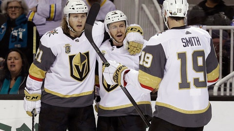 Vegas Golden Knights' Jonathan Marchessault, center, celebrates his goal with teammates William Karlsson, left, and Reilly Smith (19) during the second period of Game 6 of an NHL hockey second-round playoff series against the San Jose Sharks Sunday, May 6, 2018, in San Jose, Calif. (AP Photo/Marcio Jose Sanchez)