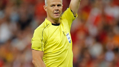 FILE - In this Saturday, Sept. 2, 2017 file photo, referee Bjorn Kuipers gestures during the World Cup Group G qualifying soccer match between Spain and Italy at the Santiago Bernabeu Stadium in Madrid. UEFA has picked two World Cup referees for its club competition finals before the tournament in Russia. UEFA says Milorad Mazic of Serbia will referee the Champions League final between Liverpool and Real Madrid on May 26 in Kiev. Bjorn Kuipers of the Netherlands will referee the Atletico Madrid-Marseille Europa League final May 16 in Lyon. (AP Photo/Paul White. File)