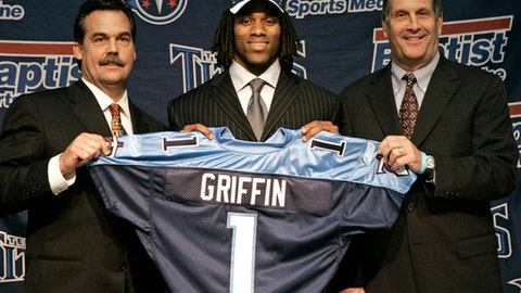 FILE - In this April 29, 2007, file photo, Michael Griffin, a safety from Texas, is introduced as the Tennessee Titans' top draft pick, in Nashville, Tenn. With Griffin are Titans head football coach Jeff Fisher, left, and general manager Mike Reinfeldt, right. Griffin signs a one-day contract to retire after nine seasons with the franchise where he played nine seasons.(AP Photo/Mark Humphrey, File)