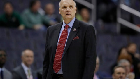 """This March 9, 2018 photo shows Saint Joseph's head coach Phil Martelli watching his team during the second half of an NCAA college basketball quarterfinal game against George Mason in the Atlantic 10 Conference tournament in Washington. Martelli said Monday, May 7, 2018 that everyone involved in college basketball needs to help """"create a new model"""" following recent reform proposals amid a federal corruption investigation into the sport. (AP Photo/Alex Brandon)"""